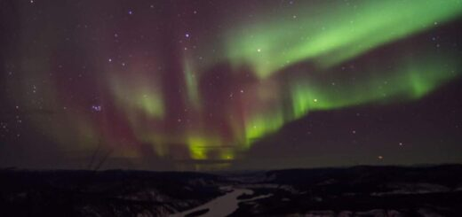 Northern lights over the Yukon River at Dawson City